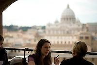 Women having lunch in a restaurant overlooking the Vatican, Rome, Italy