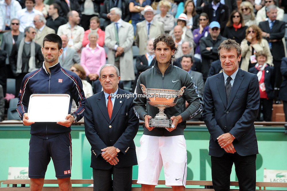 Spain's Rafael Nadal and Novak Djokovic hold the winning trophy during the award ceremony for men's singles at the French Open tennis tournament in Paris, France. Monday June 11, 2012. Photo imago/i-Images