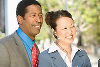 Outdoor portrait of businesspeople, smiling