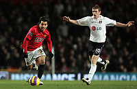 Photo: Paul Thomas/Sportsbeat Images.<br /> Manchester United v Fulham. The FA Barclays Premiership. 03/12/2007.<br /> <br /> Carlos Tevez (L) of Utd breaks past Steven Davis.