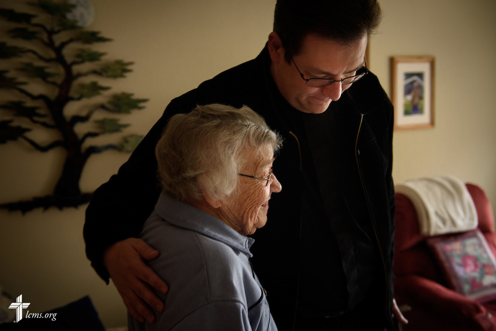 The Rev. Mark Nierman, pastor of Mount Olive Lutheran Church, hugs homebound shut-in member Bernice Schumacher after a visit with her on Thursday, March 3, 2016, in Loveland, Colo. LCMS Communications/Erik M. Lunsford