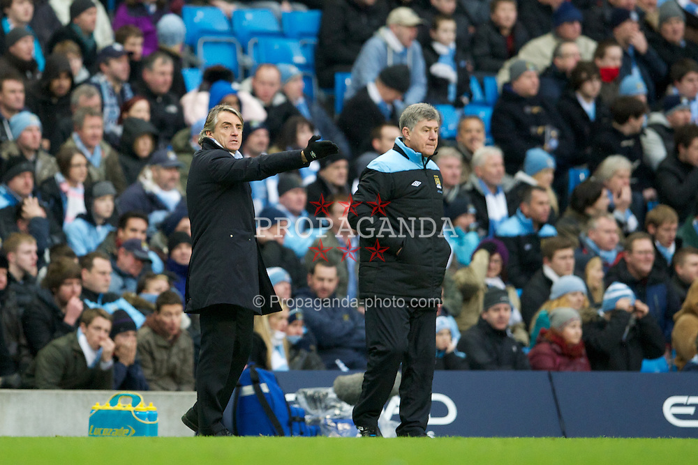 MANCHESTER, ENGLAND - Sunday, January 22, 2011: Manchester City's manager Roberto Mancini and assistant Brian Kidd against Tottenham Hotspur during the Premiership match at the City of Manchester Stadium. (Pic by David Rawcliffe/Propaganda)