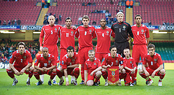 CARDIFF, WALES - Wednesday, April 1, 2009: Wales' players pose for a team group photograph before the 2010 FIFA World Cup Qualifying Group 4 match against Germany at the Millennium Stadium. Back row L-R: James Collins, Joe Ledley, Sam Vokes, Ashley Williams, goalkeeper Wayne Hennessey, Lewin Nyatanga, front row L-R: Sam Ricketts, Robert Earnshaw, Gareth Bale, mascot, captain Simon Davies, mascot, Aaron Ramsey. (Pic by David Rawcliffe/Propaganda)