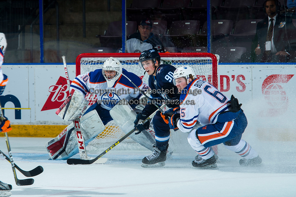 PENTICTON, CANADA - SEPTEMBER 9: Kristian Reichel #90 of Winnipeg Jets looks for the pass between Chad Butcher #65 and Stuart Skinner #50 of Edmonton Oilers on September 9, 2017 at the South Okanagan Event Centre in Penticton, British Columbia, Canada.  (Photo by Marissa Baecker/Shoot the Breeze)  *** Local Caption ***