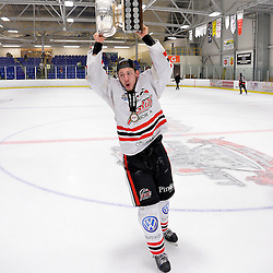FORT FRANCES, ON - May 2, 2015 : Central Canadian Junior &quot;A&quot; Championship, game action between the Fort Frances Lakers and the Soo Thunderbirds, Championship game of the Dudley Hewitt Cup. Nicolas Tassone #17 of the Soo Thunderbirds raises the Dudley Hewitt Cup.<br /> (Photo by Shawn Muir / OJHL Images)