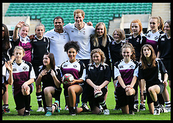 Prince Harry and Jason Robinson pose for a team photograph after taking part in a Rugby Football Union schools coaching session at Twickenham Stadium in London, Thursday, 17th October 2013. Picture by Stephen Lock / i-Images