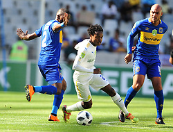 Cape Town--180401  Mamelodi Sundowns striker Percy Tau challenged by Thamsanqa Mkhize and Royn Johannes of Cape Town City during the Nedbank Cup quarter final game at the Cape Town Stadium.Sundowns won the game 2-1 and will play maritzburg in the Semi-final  .Photographer;Phando Jikelo/African News Agency/ANA