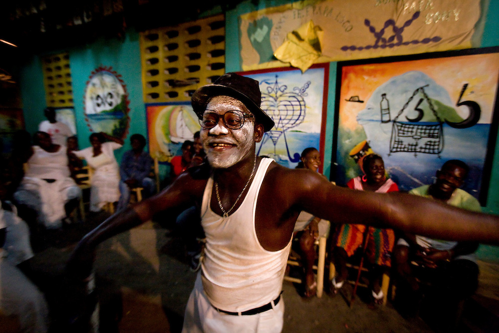 Sony Romulus is a Voodoo Priest in the photo is leading a Voodoo ceremony in a temple at the town of   Carrefour, Haiti..Wednesday February 24.2010..Keeping with a long tradition of Christian missionary work in Haiti, the January 2010 earthquake brought huge numbers of Christian organizations to the country to help the devastated population with food, shelter and spiritual guidance. But the earthquake has had another, less obvious impact. Haiti has a large traditional Voodoo population. Some evangelical Christian groups not only dismiss the Voodoo religion as a Satanic cult, but in fact blame practitioners for the earthquake, saying it was God's punishment. Voodoo spiritual leaders say this belief has led to disparate treatment of earthquake victims by Christian aid groups, with Christian converts getting better tents and food, and Voodoo congregations left unattended. The tension has erupted into violent clashes and attacks on Voodoo temples in Carrefour and Cité Soleil. Voodoo leaders say missionaries are using the promise of food and medical supplies to lure people to religious meetings to convert them and complain international aid is only going to Christian groups.