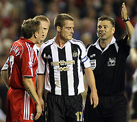 Photo: Paul Thomas.<br /> Liverpool v Newcastle United. The Barclays Premiership. 20/09/2006.<br /> <br /> Craig Bellamy (L) of Liverpool has words to Scott Parker (C) after Parker won a penalty for Newcastle.