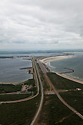 Nederland, Zuid-Holland, Ouddorp  22-05-2011; Brouwersdam, onderdeel van de Deltawerken, tussen Goeree en Schouwen met links het Grevelingenmeer de Middelplaat met recreatiecentrum en vakantiepark Port Zelande. Na het afsluiten van de zeearm Grevelingen zijn gaandeweg ernstige milieuproblemen ontstaan in het zoetwatermeer met name algengroei. Er zijn plannen om een opening in de dam te maken om zo het getij deels terug te laten keren..Brouwersdam, part of the Delta Works, between Goeree and Schouwen. Left Grevelingenmeer and Middelplaat with the recreation and park Port Zelande. The closure of the ester lead to increasing serious environmental problems in freshwater lake in particular algae. There are plans for an opening in the dam  allowing the tidiest return partially..luchtfoto (toeslag); aerial photo (additional fee required);.foto Siebe Swart / photo Siebe Swart