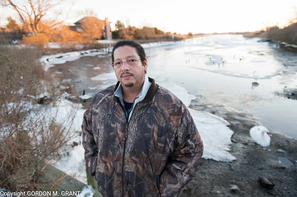 David Taobi Silva, a former Shinnecock Indian tribal leader, stands next to Taylor Creek, near where he received a ticket last April for illegal fishing, in Southampton, Jan. 3, 2018. He is due back in court this month seeking to dismiss the charges in a case that prompted him to file a discrimination complaint against the state and assert the tribe's ancient fishing rights.