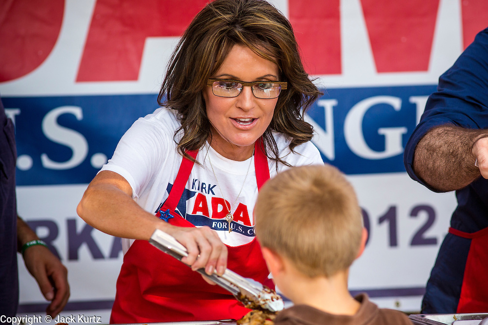 27 AUGUST 2012 - GILBERT, AZ: SARAH PALIN serves barbecue at a campaign barbecue for Kirk Adams, a candidate for US Congress, Monday. Sarah Palin campaigned for Arizona Republicans aligned with the Tea Party movement at a barbecue in Gilbert, AZ, a suburb of Phoenix. She campaigned for Kirk Adams, who is running for Congress and Jeff Flake, who is running for US Senate. Palin spoke and served barbecued chicken in 108 degree heat.       PHOTO BY JACK KURTZ