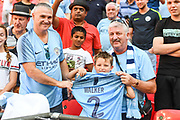 A young Manchester City fan is given Manchester City Defender Kyle Walker's (2) shirt after the FA Community Shield match between Chelsea and Manchester City at Wembley Stadium, London, England on 5 August 2018. Picture by Stephen Wright.