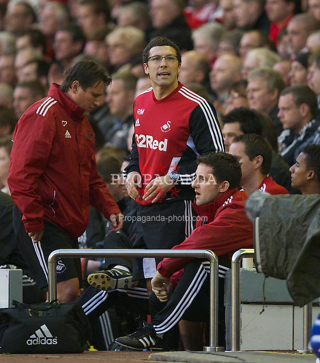 LIVERPOOL, ENGLAND - Saturday, November 5, 2011: Swansea City's fitness coach Ryland Morgans on the bench during the Premiership match against Liverpool at Anfield. (Pic by David Rawcliffe/Propaganda)