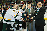 Vermont Captain's Brendan Bradley (20) and Mario Puskarich (21) take the trophy at end of the men's hockey game between the Vermont Catamounts and the Quinnipiac Bobcats in the championship game of the Friendship Four hockey tournament at the SSE Arena on Saturday evening November 26, 2016 in Belfast, Ireland. (BRIAN JENKINS/for the FREE PRESS)