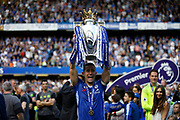 Chelsea Defender Gary Cahill (24) celebrates with the trophy during the Premier League match between Chelsea and Sunderland at Stamford Bridge, London, England on 21 May 2017. Photo by Andy Walter.