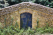 Doorway in stone wall, Sandford St Martin, England, United Kingdom