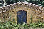 Doorway in stone wall, Sandford St Martin, England, United Kingdom