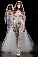 A model walks the runway wearing Naeem Khan Bridal Spring 2018