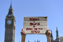 June 10, 2017 - London, UK - London, UK. Protesters gather in Parliament Square to demonstrate against the prospect of a Tory coalition with the DUP, as well as to celebrate Labour gains, following the General Election which resulted in a hung Parliament  (Credit Image: © Stephen Chung/London News Pictures via ZUMA Wire)