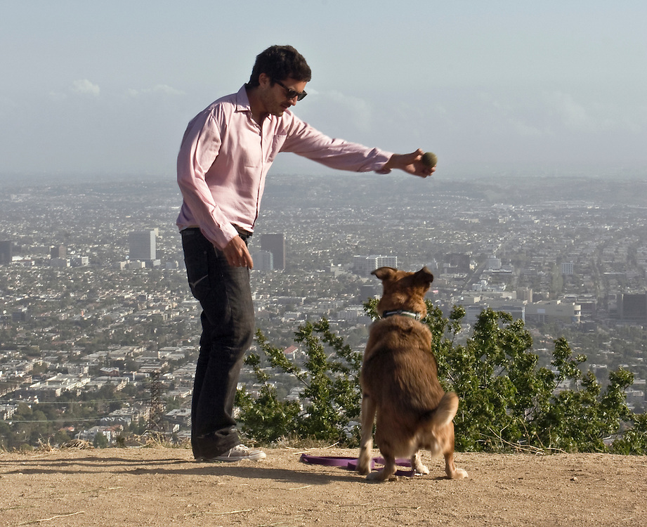 Dog-trainer Alejandro Cardenas during a working day in Los Angeles, CA, USA.