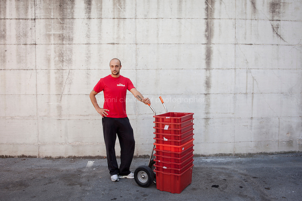 SERRAVALLE, SAN MARNO - 3 OCTOBER 2011:  Fabio Bollini , 28, who plays as a defender in the San Marino national soccer team, works at Traslocasa, the moving company he owns with his brother, in San Marino on October 4, 2011. Fabio Bollini . The San Marino national football team is the last team in the FIFA  World Ranking (position 203). San Marino, whose population reaches 30,000 people, has never won a game since the team was founded in 1988. They have only ever won one game, beating Liechtenstein 1&ndash;0 in a friendly match on 28 April 2004. The Republic of San Marino, an enclave surronded by Italy situated on the eastern side of the Apennine Moutanins, is the oldest consitutional republic of the world<br /> <br /> <br /> ph. Gianni Cipriano