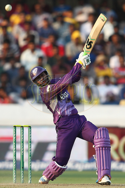 Shoaib Malik of the Hobart Hurricanes hits over the top during the first semi final match of the Oppo Champions League Twenty20 between the Kolkata Knight Riders and the Hobart Hurricanes held at the Rajiv Gandhi Cricket Stadium, Hyderabad, India on the 2nd October 2014<br /> <br /> Photo by:  Shaun Roy / Sportzpics/ CLT20<br /> <br /> <br /> Image use is subject to the terms and conditions as laid out by the BCCI/ CLT20.  The terms and conditions can be downloaded here:<br /> <br /> http://sportzpics.photoshelter.com/gallery/CLT20-Image-Terms-and-Conditions-2014/G0000IfNJn535VPU/C0000QhhKadWcjYs