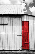 The red door on this tin barn caught my eye while traveling through the some local back roads.