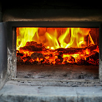 The fire in the outdoor wood-fired oven at Dufferin Grove park in Toronto.