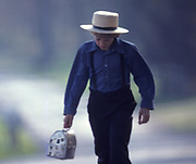 Amish school boy going to one-room school with lunch pail, Lancaster Co., PA