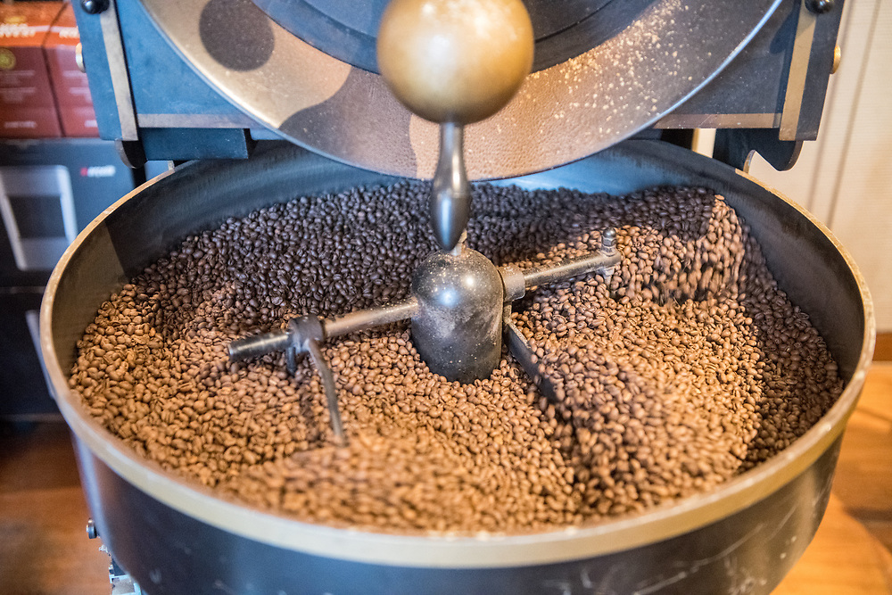 A mechanical arm of a machine slowly rotates freshly roasted coffee beans to cool them down, Istanbul, Turkey