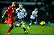 Johnny Russell of Derby County (right) competing with Tommy Spurr of Blackburn Rovers (left) during the Sky Bet Championship match at the iPro Stadium, Derby<br /> Picture by Andy Kearns/Focus Images Ltd 0781 864 4264<br /> 24/02/2016