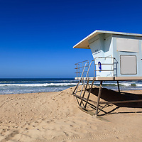 Photo of Huntington Beach lifeguard tower. Huntington Beach is a seaside beach city in Orange County Southern California and is also known as Surf City USA.