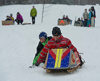 "Seth and Sander Valpey try to get some momentum going on their ""Thing 3"" sled during Gilford Parks and Recreation's annual Cardboard Derby at the Outing Club on Wednesday morning.  (Karen Bobotas/for the Laconia Daily Sun)"