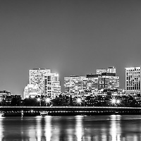 Boston skyline at night black and white panorama picture with Back Bay buildings, Harvard Bridge, Charles River, John Hancock Tower, and Prudential Tower. Boston Massachusetts is a major city in the Eastern United States of America. Panorama photo ratio is 1:3.