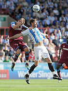 Picture by Graham Crowther/Focus Images Ltd. 07763140036.10/9/11 .Jamie McCombe of Huddersfield outjumps Ash Taylor of Tranmere during the Npower League 1 game at the Galpharm Stadium, Huddersfield.
