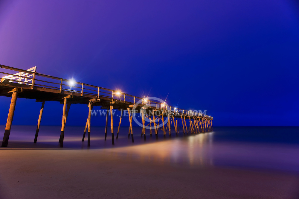 Wrightsville Beach Oceanic Pier rests in the warm moments just before sunrise along the North Carolina coast.  PHOTO BY:  JEFF JANOWSKI.www.JeffJanowskiPhotography.com