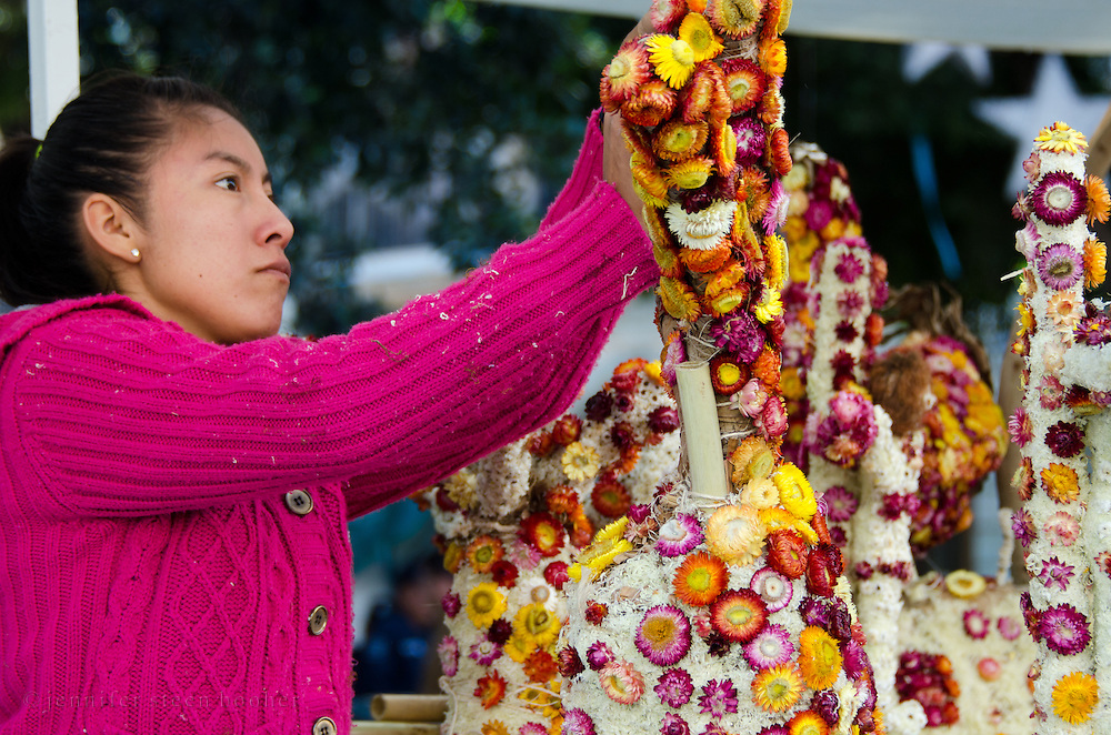 Woman assembling dried flower sculpture for Noche de Rabanos, Oaxaca, Mexico.