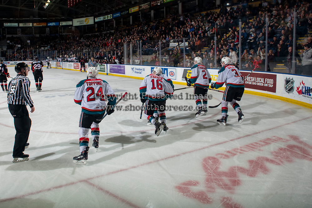 KELOWNA, CANADA - FEBRUARY 8: Kyle Topping #24, Michael Farren #16, Mark Liwiski #9, Lassi Thomson #2, and Dalton Gally #3 of the Kelowna Rockets skate to the bench to celebrate a third period tie breaking goal against the Prince George Cougars on February 8, 2019 at Prospera Place in Kelowna, British Columbia, Canada.  (Photo by Marissa Baecker/Shoot the Breeze)