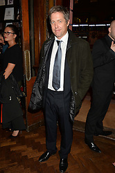 HUGH GRANT at a party to celebrate the launch of the Maison Assouline Flagship Store at 196a Piccadilly, London on 28th October 2014.  During the evening Valentino signed copies of his new book - At The Emperor's Table.