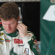 Sprint Cup Series driver Dale Earnhardt Jr. (88) rests in the garage area at Daytona International Speedway on February 18, 2011 in Daytona Beach, Florida. (AP Photo/Alex Menendez)