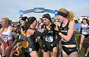 Nov 17, 2018; Madison, WI, USA; Members of the Colorado women's team Makena Morley (57), Dani Jones (55) and Tabor Scholl (58) celebrate after the Buffaloes won the women's team title  during the NCAA Cross Country Championships at the Thomas Zimmer Championship Course.