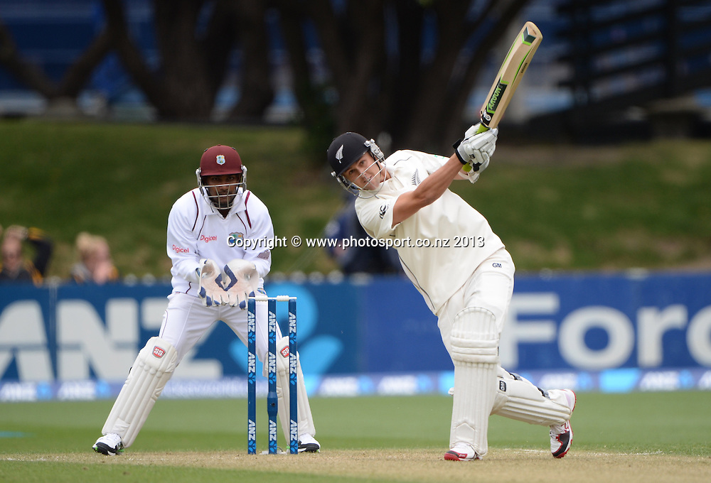 Trent Boult batting as Denesh Ramdin looks on during play on Day 2 of the 2nd cricket test match of the ANZ Test Series. New Zealand Black Caps v West Indies at The Basin Reserve in Wellington. Thursday 12 December 2013. Mandatory Photo Credit: Andrew Cornaga www.Photosport.co.nz