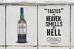 View of old adverts for whisky at Laphroaig Distillery on island of Islay in Inner Hebrides of Scotland, UK