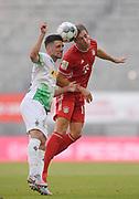 Joshua ZIRKZEE, FCB 35 gegen Matthias GINTER, MG 28  during the Bayern Munich vs Borussia Monchengladbach Bundesliga match at Allianz Arena, Munich, Germany on 13 June 2020.