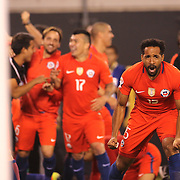 EAST RUTHERFORD, NEW JERSEY - JUNE 26:  Jean Beausejour #15 of Chile celebrates his sides victory after the penalty shoot out during the Argentina Vs Chile Final match of the Copa America Centenario USA 2016 Tournament at MetLife Stadium on June 26, 2016 in East Rutherford, New Jersey. (Photo by Tim Clayton/Corbis via Getty Images)