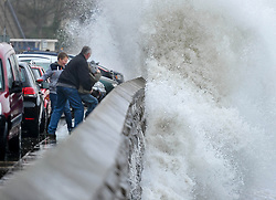 (c) Licenced to London News Pictures 21/03/2015. Scarborough, North Yorkshire, UK. High tide brings huge waves to the shore at Scarborough. Photo credit : Harry Atkinson/LNP