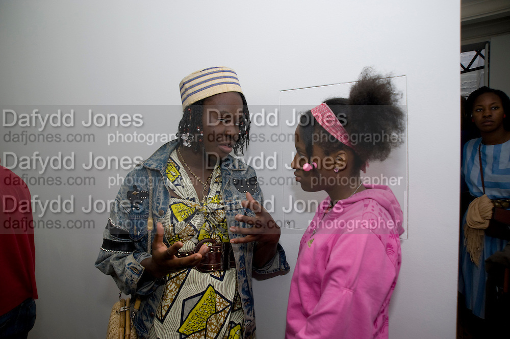 JOSEPHINE CHIME; JOANNE ISIGUZO, Cindy Sherman exhibition. Spruth Magers, London. Grafton st. London. Afterwards at Bellamy's, Bruton Place. 15 April 2009.  *** Local Caption *** -DO NOT ARCHIVE-© Copyright Photograph by Dafydd Jones. 248 Clapham Rd. London SW9 0PZ. Tel 0207 820 0771. www.dafjones.com.<br /> JOSEPHINE CHIME; JOANNE ISIGUZO, Cindy Sherman exhibition. Spruth Magers, London. Grafton st. London. Afterwards at Bellamy's, Bruton Place. 15 April 2009.