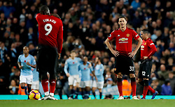 Manchester United's Nemanja Matic appears dejected after Manchester City's Ilkay Gundogan scores his side's third goal of the game during the Premier League match at the Etihad Stadium, Manchester.