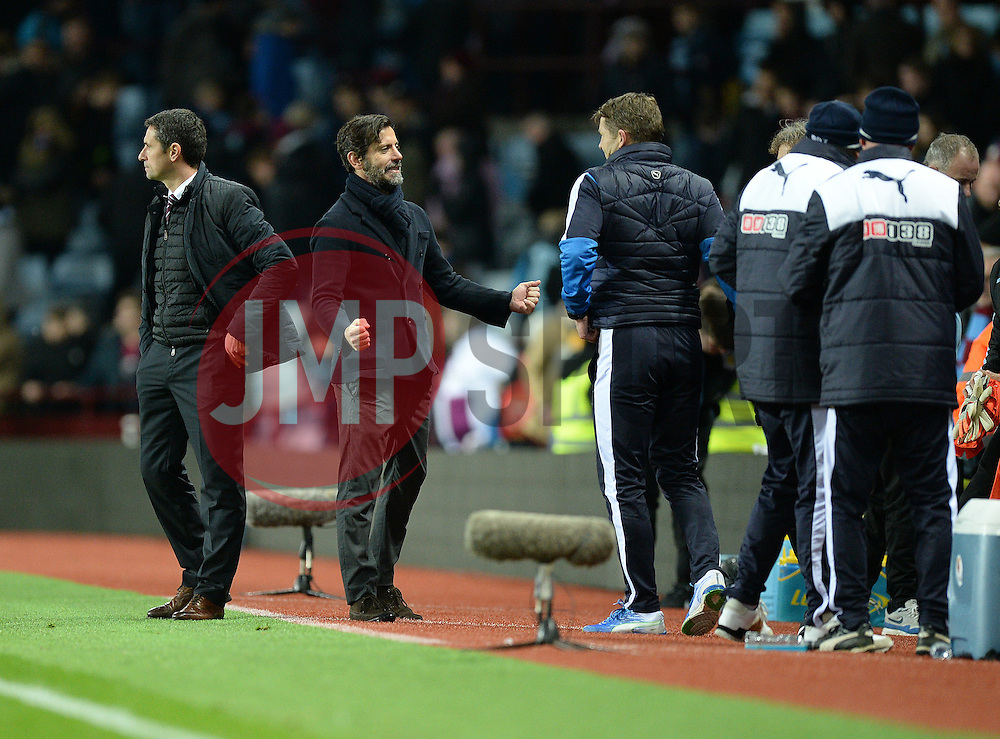 Watford Manager Quique Flores turns around to celebrate with his back room staff after shaking hands with Aston Villa Manager Remi Garde - Mandatory byline: Alex James/JMP - 28/11/2015 - Football- Aston Villa  - Birmingham, Watford  - Aston Villa v Watford - Barclays Premiership